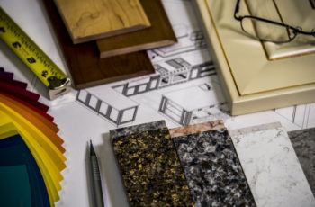 Home design materials; paint, trim, and counter top samples.