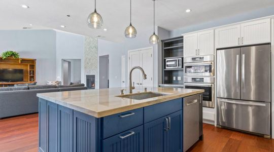 Modern kitchen remodel: island counter top with sink.