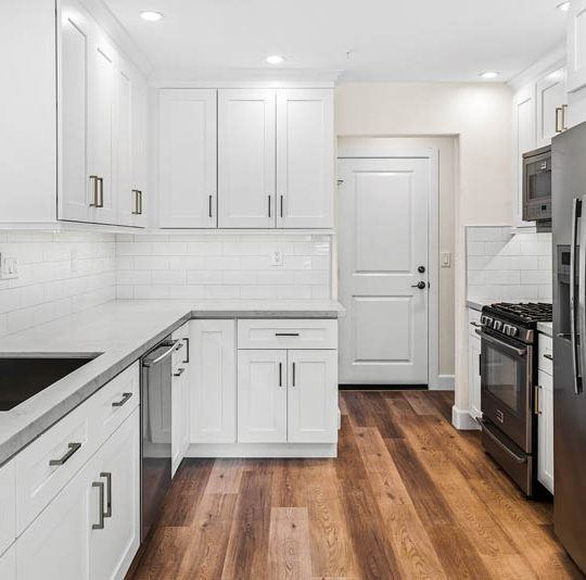 White decor interior of home with kitchen cabinets.